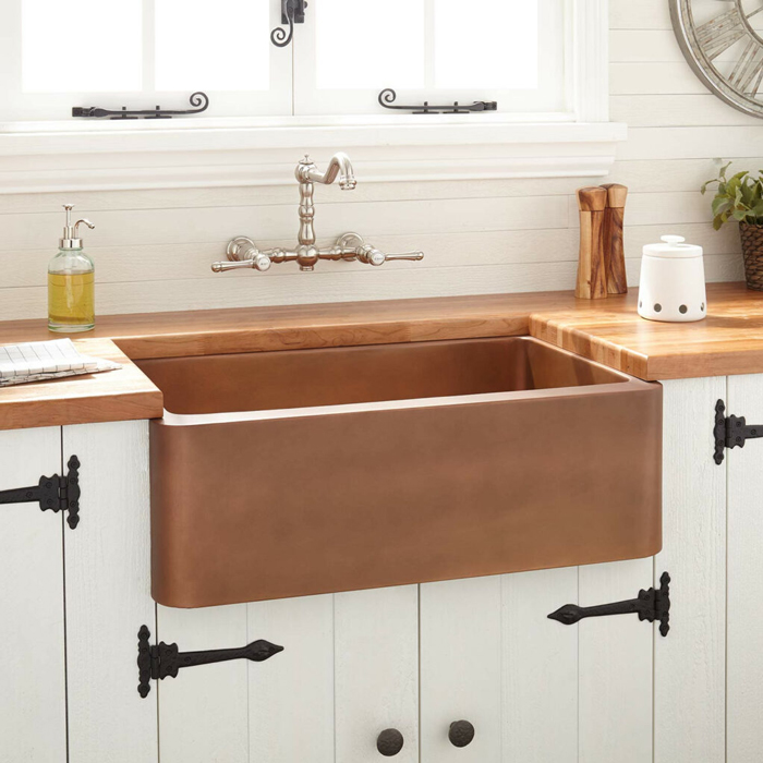 How do you maintain copper farmhouse sinks
